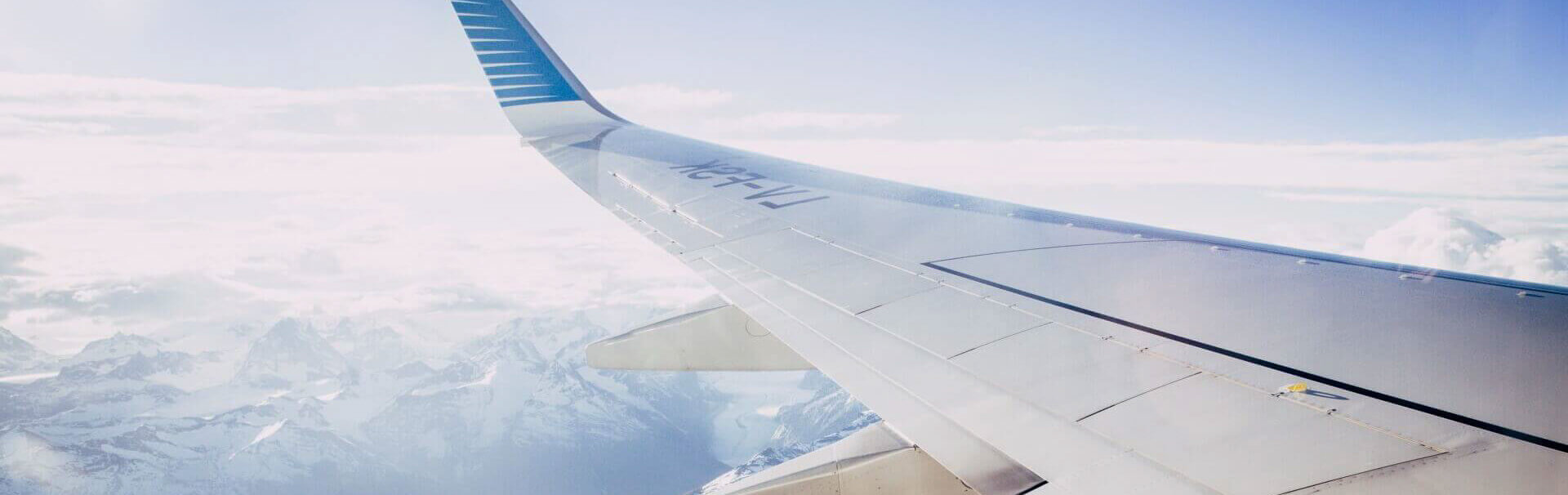 The wing of a plane flying